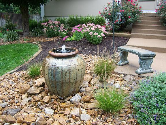 Landscape planning water features can transform your for Simple water features for backyard